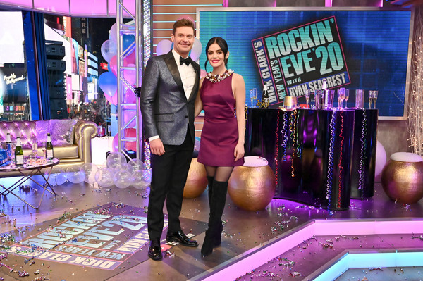 Lucy Hale attended Dick Clark's New Year's Rockin' Eve wearing a sleeveless burgundy mini dress.