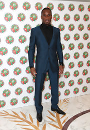 Didier Drogba was a style standout in a perfectly tailored teal suit during his foundation's charity ball.