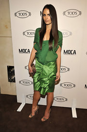 Jordana added an exotic pair of snakeskin pumps to her bold green look. We would've preferred a nude strappy sandal but she attempted to tie in her clutch.
