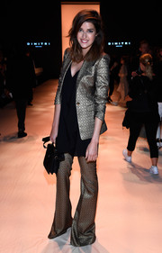 Marie Nasemann was funky-glam at the Dimitri fashion show in a gold bell-bottom pantsuit teamed with a long black blouse.
