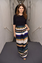 Marisa Tomei glammed up her plain top with a chic striped maxi skirt.