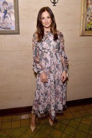 Minka Kelly looked prim in a floaty long-sleeve floral frock at the Dinner for Equality.