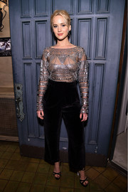 Jennifer Lawrence polished off her outfit with a pair of high-waisted velvet pants, also by Naeem Khan.