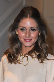 Olivia Palermo added a pair of false lashes for eye-opening effect at the Dior fashion show in Paris.