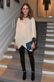 Olivia Palermo topped off her edgy ensemble with black ankle boots.