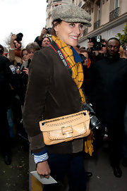 Ines de la Fressange bundled up in Paris with a yellow flannel scarf.