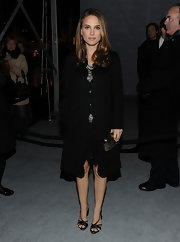 Natalie Portman donned dainty black satin heels to a Dior celebration. The delicate shoes balanced out her black wool coat.