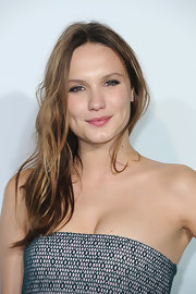 Ana Girardot showed of her blonde highlights with an effortlessly natural wavy 'do.