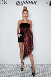 Hailey Baldwin got glitzed up in an Alexandre Vauthier mini dress with an oversized sequined sash for the Dior dinner during Cannes.
