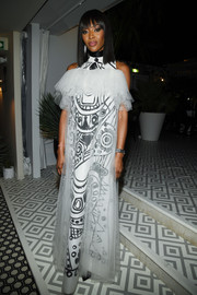 Naomi Campbell looked avant-garde in a black-and-white print gown with a sheer overlay at the Dior dinner during Cannes.