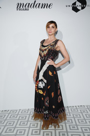 Clotilde Courau was tribal-glam in a fringed, printed gown at the Dior dinner during the Cannes Film Festival.