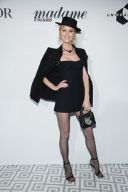 Eva Herzigova topped off her outfit with a black military jacket.