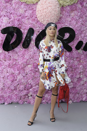 Rita Ora styled her dress with funky knee-strap heels.