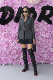 Aimee Song rounded out her look with a pair of black thigh-high boots.