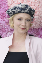 Gwendoline Christie accessorized with a printed beret by Dior during the label's Menswear Spring 2019 show.