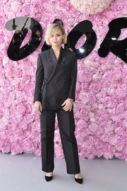 Christina Ricci opted for a black pantsuit by Dior when she attended the label's Menswear Spring 2019 show.