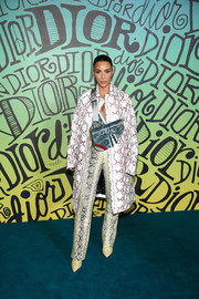 Kim Kardashian channeled her inner rockstar in a python print coat at the Dior Men Fall 2020 show.