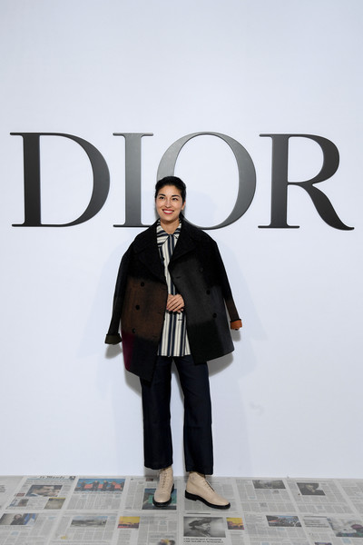 Caroline Issa bundled up in a multicolored pea coat for the Dior Fall 2020 show.