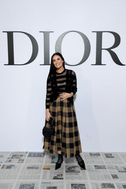 Demi Moore accessorized with the celeb-favorite Dior Saddle bag, in black.