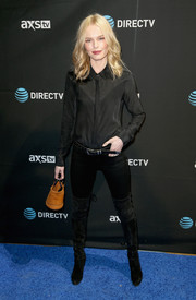 Kate Bosworth kept it subdued in an all-black button-down, pants, and over-the-knee boots combo during DirecTV Super Saturday Night.