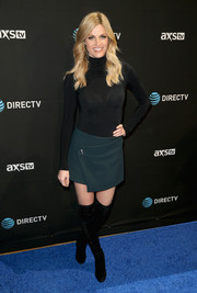 Erin Andrews amped up the '60s feel with a pair of black over-the-knee boots.