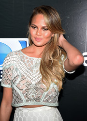 Chrissy Teigen wore her hair down with feathery waves during the DirecTV Super Saturday Night.