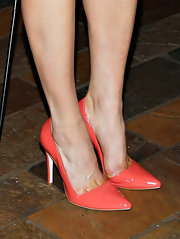 Leah Gibson chose a pair of coral pumps to add some springtime fun to her evening look.