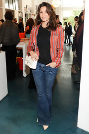 Gina Gershon kept it casual in bootcut jeans, a tee, and a striped blazer at the Director's Circle party.