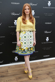 Jessica Chastain matched her frock with a pair of yellow platform peep-toes by Christian Louboutin.