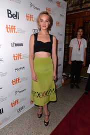 Jess Weixler completed her trendy ensemble with black platform peep-toes and a lime-green cutout skirt.