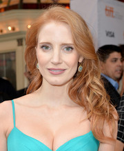 For added glamour, Jessica Chastain accessorized with a pair of dangling aquamarine earrings by Irene Neuwirth.