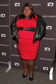 Gabourey Sidibe chose a black leather jacket to pair over her red cocktail dress to giver her look a little bit of an edgy vibe.