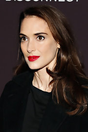The only color Winona Ryder to liven up her monochromatic evening look needed was a vibrant red lipstick.