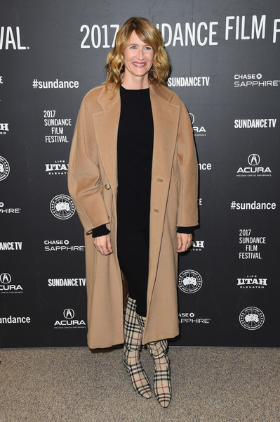 Laura Dern styled her outfit with a pair of knee-high plaid boots by Burberry.