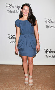 Natalie's blue silk, short-sleeved dress is perfect for day to night.