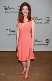 Dana paired her orange strappy sandals with a coral day dress.
