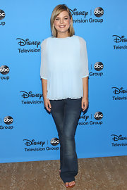 Flare jeans balanced out Kristen Storms' flowing blouse.