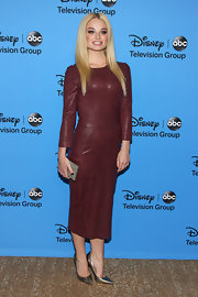 Emma wore this rich burgundy-hued leather dress to the 2013 Summer TCA Tour.
