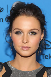 Camilla balanced out a rich smoky eye with a subtle pink pout.