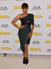 Tyra Banks showed her unique sense of style with this green one-sleeve dress, featuring a black leather bustier and skirt underlay, during the Disney Group's Summer TCA Press Tour.