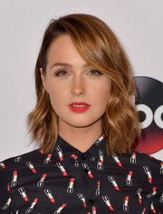 Camilla Luddington livened up her beauty look with bright red lipstick.