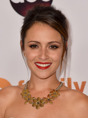 Italia Ricci accessorized with a lovely flower statement necklace during the Disney Group's Summer TCA Press Tour.