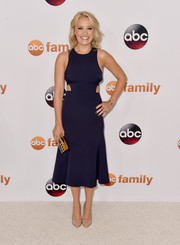 Emily Osment donned a trendy navy cutout dress for the Disney Group's Summer TCA Press Tour.