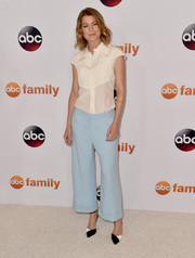 Ellen Pompeo paired her blouse with cute pastel-blue wide-leg pants.