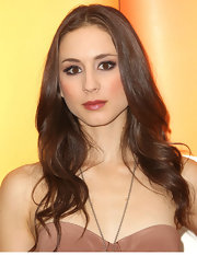 Troian Bellisario looked downright sophisticated at the 2011 May Press Junket with this long center-parted wavy 'do.