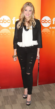 We don't often see distressed denim on the red carpet, but Ashley Benson pulls it off!