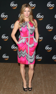 Jes Macallan brought a jolt of color to the TCA Summer Press Tour with this hot-pink and gray print dress.