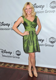 Eloise Mumford topped off her green style with nude patent leather pumps.