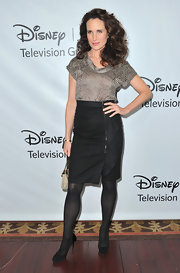 Andie MacDowell took a walk on the wild side in a leopard print blouse and a ruched zipper-front pencil skirt.