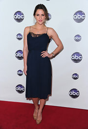 Jill Wagner wore a romantic knee length navy blue dress with peekaboo lace trim to the TCA Winter Press Tour.